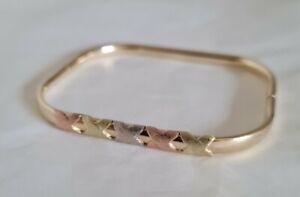 Modern 14 ct Yellow , White & Rose Gold cuff bangle. Of rectangular form.