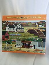 "HOMETOWN Collection - 1000 piece puzzle - ""Barn Raising"" - Artist Heronim"