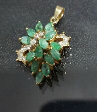 14k yellow gold penfant with diamonds and emeralds