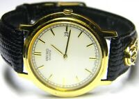 mens Seiko 10k Solid Gold Emblem 3 Real Emeralds dress watch model # 7N29-8058