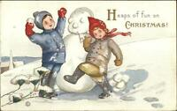 Christmas Boy & Girl Make Snowman MEP Margaret Evans Price c1910 Postcard