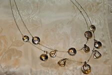 VINTAGE SILVER TONE HAMMERED DISK INVISABLE WIRE 2 STRAND NECKLACE VERY CHIC!