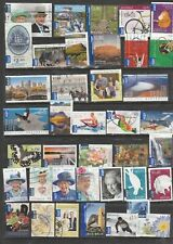 39 USED INTERNATIONAL POST STAMPS.