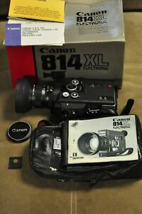 Canon model 814XL super 8 movie camera with accessories. READ.