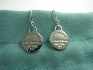 Return to Tiffany & Co Sterling Silver Mini Round Tag Earrings Hook Pierced NEW