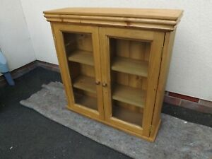 Pine 2 door glazed wall unit made by our own carpenter. 70cm width.