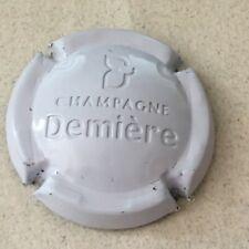 Capsule de Champagne DEMIERE A et J. estampée vert