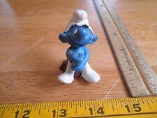 Smurf figure holds something with 2 hands VINTAGE Schleich Peyo 1979