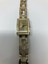 Ladies Guess Watch With Gold Color Diamond Look And Square Face