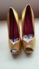 Ladies gold high heel shoes size 8