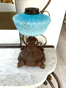 antique cast iron and embossed turquoise oil lamp