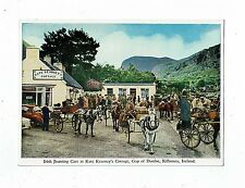 POST CARD COLOUR PHOTO IRISH JAUNTING CARS AT KATE KEARNEY`S COTTAGE, GAP OF DUN