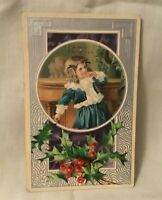 Antique Embossed Christmas Postcard A MERRY CHRISTMAS Boy and Holly and Berries