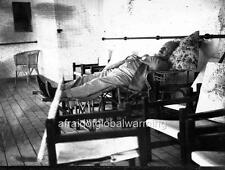 Old Photo. Man Sleeping on a Lounge Chair on Deck of Ship