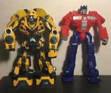 Hasbro Transformers lot of 2 2006 Lights and Sounds Bumble Bee 2014 Optimus READ