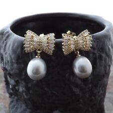 Gray Rice Pearl Bow CZ Earrings