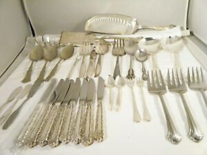 Lot of 33 Assorted flatware serving pieces, Rogers and one Gorham Fish knife.