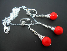 A RED CORAL BEAD NECKLACE AND CLIP ON EARRINGS SET. NEW.