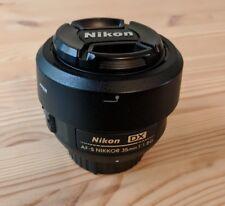 Nikon Nikkor AF-S 35mm f/1.8G DX lens with bag