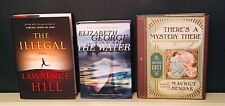 There's a Mystery There book+the illegal novel+the edge of the water book.