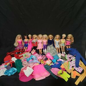 Lot of ten 80s & 90s Barbies including half pound of clothes and accessories