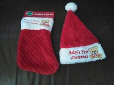 "Red and White Christmas Stocking and Hat With Message ""Baby's First ""Christmas"""