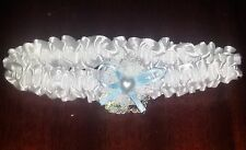 Brides white satin and blue bow garter with pearl heart detail.