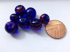 Blue glass beads with a red pattern. Set of 7
