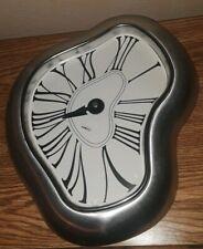 Kirch brushed silver wall clock, dali inspired w/roman numerals, hangs flat