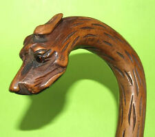 jolie canne d'art populaire sculptée d'une tête de chien