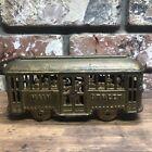 ANTIQUE CAST IRON MAIN STREET TROLLY CAR COIN BANK
