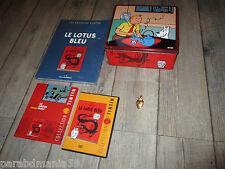 Vente Hergé-Tintin-Lot Lotus bleu-Boite métal,pin s doré,livres,dvd