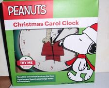 PEANUTS CHRISTMAS CAROL CLOCK PLAYS ONE OF TWELVE CAROLS ~ SNOOPY WITH STOCKING