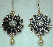 Black flower enamel effect drop earrings in gold tone faux pearl drop. 5cm