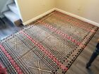 Hand woven Moroccan Kilim wool rug (red, gold, and black)