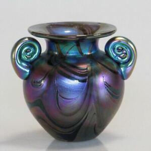 Iridescent glass pot with scrolls by Australian artist Sean O'Donoghue