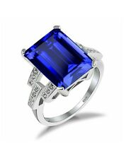 White gold finish stimulated blue sapphire  created diamond ring
