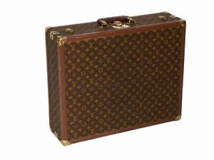 Louis Vuitton monogram suitcase trunk open by center, square handle.