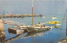 ME, Maine   ROCKLAND HARBOR-Boat at the Docks & Seaplane on the Water   Postcard