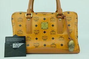 100% Authentic MCM Cognac Visetos Boston Hand Bag With Lion Gold Color Pendant