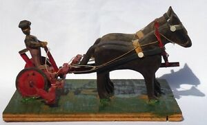 A folky carved farming scene: 2 horses, doubletree rig, cutter, more.