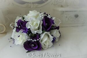 WEDDING FLOWERS SMALL TABLE CENTREPIECE/ LARGE CAKETOPPER IN CADBURYS PURPLE AND