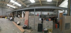 Steel mezzanine deck frame approximately 18m x 7m with stairs