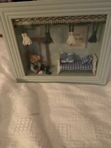 Small Teddy Bear In A Wall Decor Picture Frame With His Bedroom