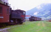 PHOTO  AUSTRIAN RAILWAYS - TRAINS CROSSING ON THE 76CM GAUGE ZILLERTALBAHN IN TH