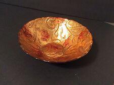 Decorative art glass bowl shimmering gold orange swirl with black base