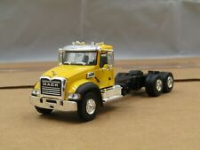 dcp/greenlight yellow Mack Granite cab&chassis truck 3 axle 1/64.,