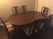 Thomasville dining table with six chairs and two extension boards