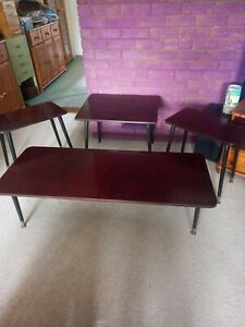 Handcrafted set of 4 bakelite tables used as coffee table/side tables. Unique.