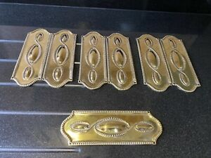 A LOVELY SET OF 7 VICTORIAN BRASS PROFESSIONALLY POLISHED DOOR OR FINGER PLATES.